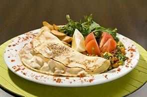 Crêpes con zucchine patate e emmental