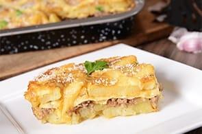 Patate al forno gratinate, prosciutto e brie